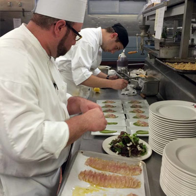 Chefs preparing food in restaurant